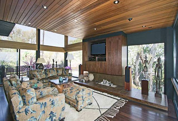 The living room is expansive and seems to breathe life into the home. With natural light flooding through its massive windows, gorgeous wood above and below, and classic lines, it's easy to understand why it was selected as one of the homes on a 1960's Architecture Tour by the Los Angeles Conservancy.