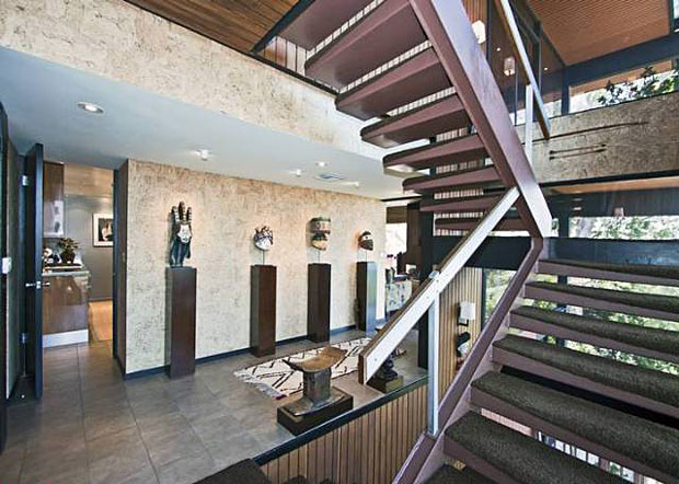 I love a floating staircase. Combine that with a loft style arrangement, and this home delivers a grand sense of spaciousness.