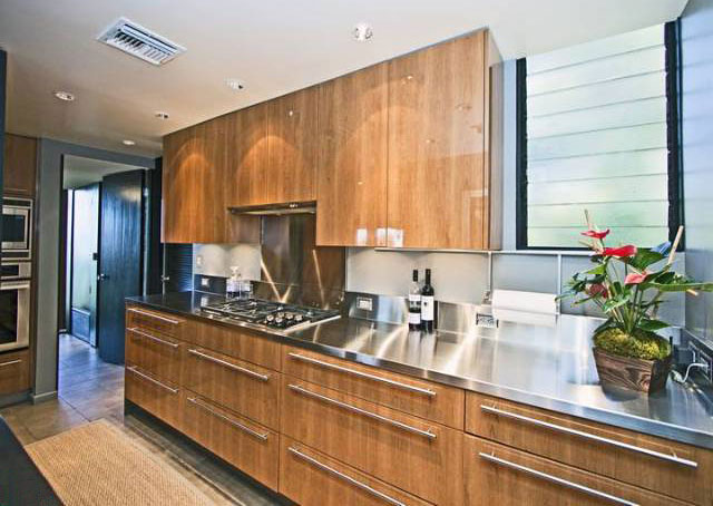 Although the rest of the house proudly proclaims it's 60's heritage, the kitchen is all modern with choices in finishes that are stunning.