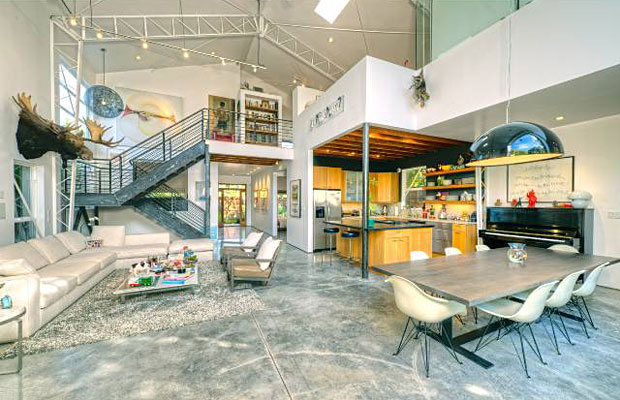 Built in 2003 this architectural gem features polished concrete floors, towering ceilings with exposed trusses, a wide-open floor plan, and steel staircases that give the place a hip, post-industrial loft vibe.