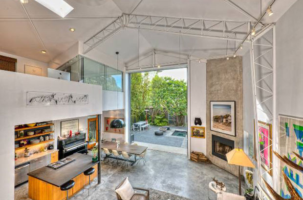 This place has an abundance of natural light from the massive doors and also from skylights overhead. But since your art will need lighting, you'll be happy to know that the home also features plenty of track lighting designed for just that.