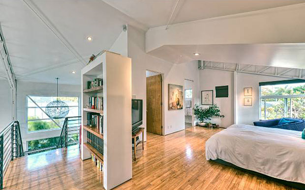 The home boasts 2 bedrooms, 2 baths, a mezzanine, plus den/office or 3rd bedroom and its layout provides a balance of openness and privacy while maintaining great flow and natural light.