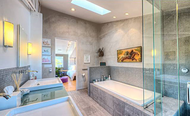 The bedrooms on the upper level features spacious walk-in closets and the master suite offers a separate tub/shower and dual sinks.