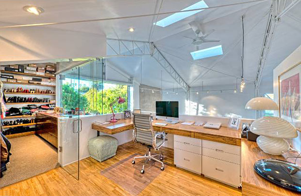 This awesome office and adjoining closet overlook the main living area below.