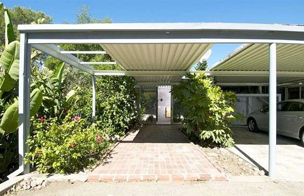 No garage here. Just a classic carport and a covered walkway leading to the front door.