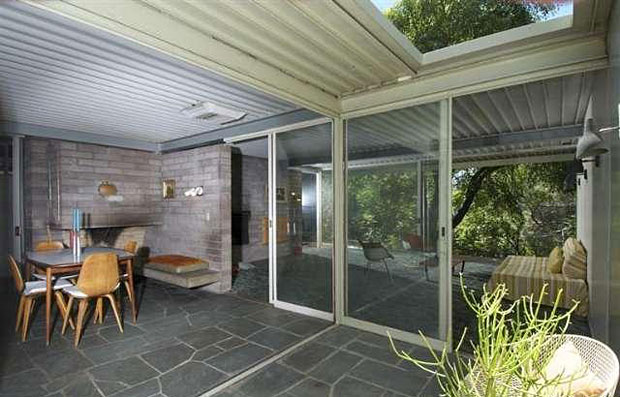 The slate flooring of the kitchen extends beautifully to the patio outside.