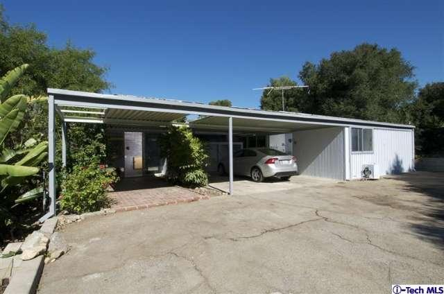 With 2 BR / 2 BA and 1,429 square feet of living space, this home definitely falls into the 'modest' category. But if that's enough space for you, I say give this one a look-see and maybe buy into a great piece of SoCal's rich architectural legacy.