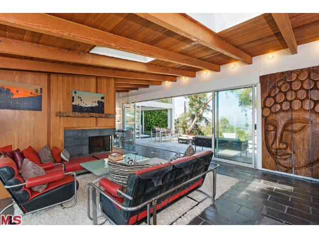 Highlights of this 1953 square foot home include two living areas, vaulted ceilings with skylights, sliding walls of glass, bamboo and stone floors, and a European kitchen featuring Miele appliances.