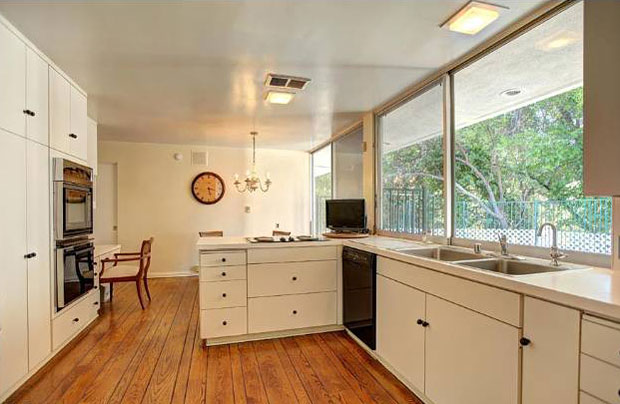 The kitchen is spacious, with an eat-in area that open up to the beautiful backyard patio.