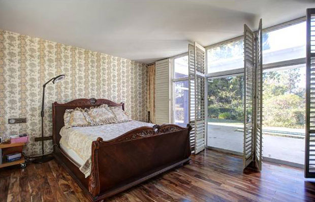 Three bedrooms, including a large master with walk-in-closet and bath, are situated on opposite ends of the home for intra-family privacy.