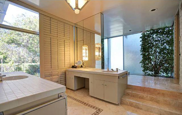 Thoughtful, interesting design concepts shouldn't end at the bathroom door. This bathroom is not merely spacious, but its use of multiple levels, glass walls looking outside, and greenery inside offers a unique feeling of indoor-outdoor living and luxury.