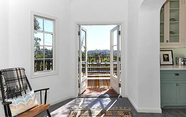 Off to the side of the kitchen is an office nook, which flows out to a redwood deck with gorgeous views.