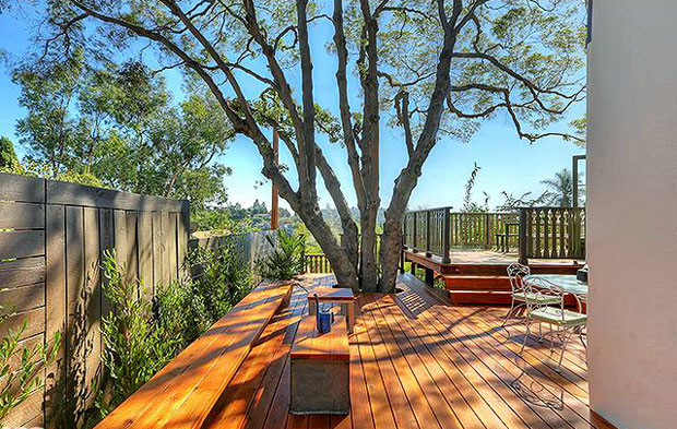 Another recurring design element are beautiful decks to that are built around existing trees.