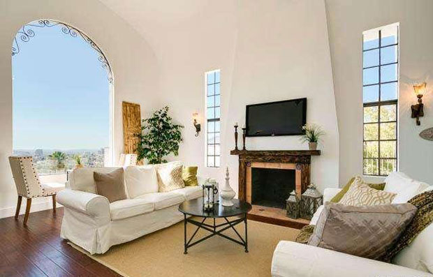 Vaulted ceilings and a classic arched picture window are among the charming features that have been retained in this home.