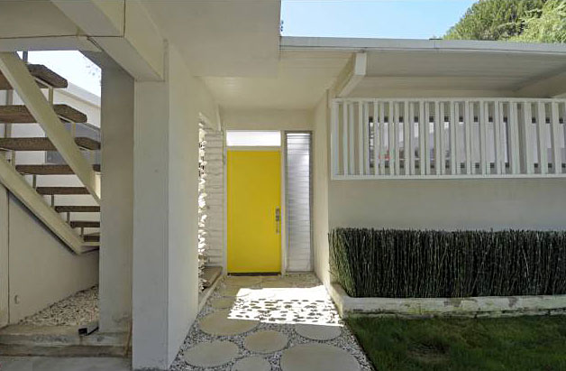 From the moment you approach this home, which has been featured in publications multiple times, you'll love the classic design elements. Although it may or may not have been the original choice of the architect, I happen to love the choice of a very bold yellow for the front door.