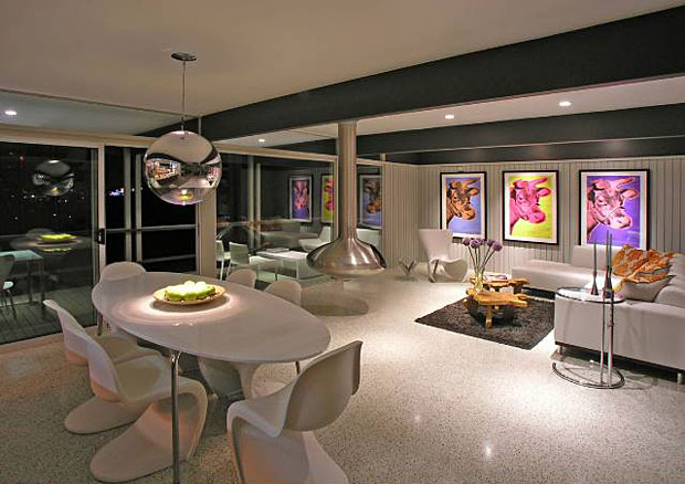 Looking for cool factor? If George Jetson were shopping for a fireplace, I bet he would choose a suspended and fully rotating Fireorb, just like the one in this home's living room.