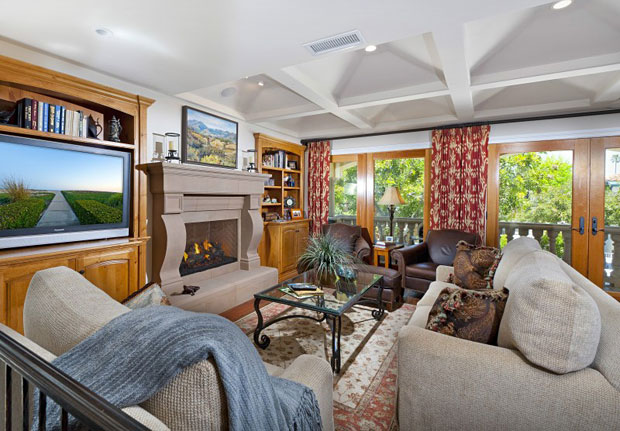 Only one home away from the sand and just a few blocks to the bay with docks and boats galore, this estate offers grand volume while mating intimacy, comfort and the quintessential beach lifestyle. (Not to mention the fact that it's priced great against its comps.)