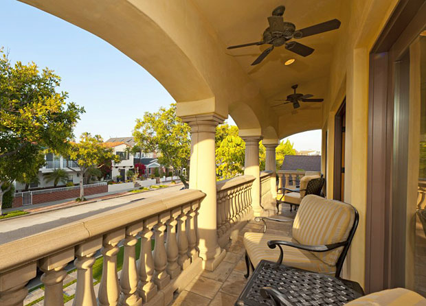 The first of these outdoor areas is a long balcony that extends the full width of the home right off the living and dining room. With an east-facing orientation, this is the perfect place to enjoy a morning cup of coffee as the sun rises and the neighborhood below comes to life.