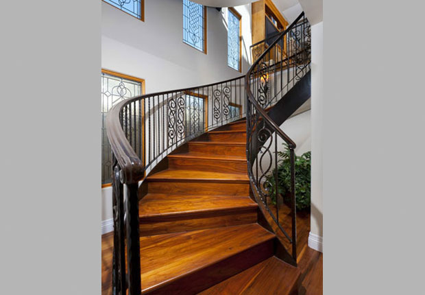 This sweeping handmade staircase, which accesses all three levels, is just one of many examples in this home where art and form follow function.