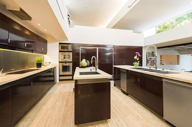 A huge chef's kitchen is completely modern and features a breakfast bar.