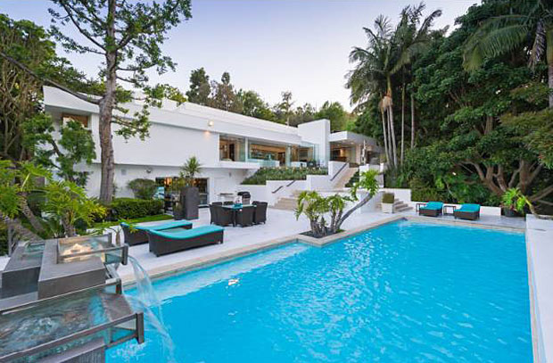 With large terraces and poolside patios surrounded by lush foliage, this is a true backyard oasis.