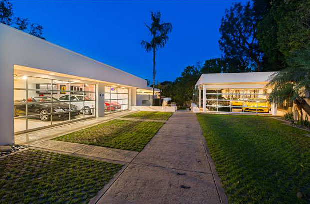 Everything about this home is a showcase, even the garages, which are more aptly described as automobile galleries. Combined, they'll accommodate up to nine cars.