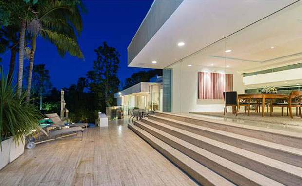 All in all, the property, which includes a separate guest house, features 5 bedrooms, 7 baths, and 7,641 s.f. of living space.
