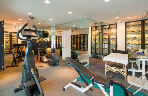 Of course, this place is outfitted with rooms for every purpose, including this rockin' gym. If Kobe Bryant is reading this, that's a great place for the trophies!