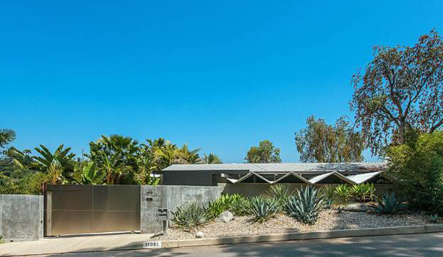 Even from the street, where most of the home is hidden from view, you can tell that what lies behind the privacy wall is more than just a box. The butterfly roof of the garage hints at the interesting lines and angles, which abound in this home.