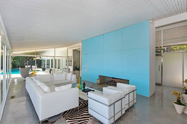 The home features 4 BR / 3 BA and 2,942 square feet of living space. And the polished cement flooring adds to the sleek luster of this light and bright home.