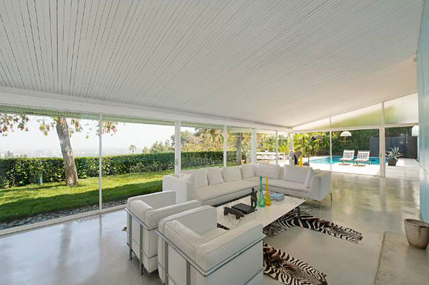 Sliding glass doors are found along the entire rear of the home, providing the ultimate indoor-outdoor flow.
