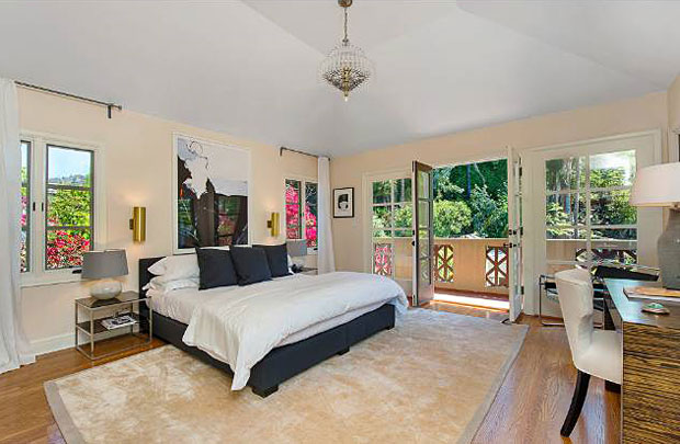 All of the bedrooms are located upstairs and two of them lead out to a balcony that overlooks the park-like back yard. The master suite has high ceilings and gorgeous master bath with a huge walk in closet.