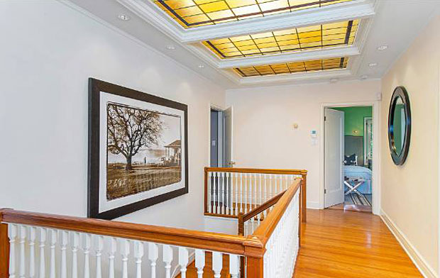 A lovely vestige of this home's past is this vintage leaded glass skylight that illuminates the entry hall below.