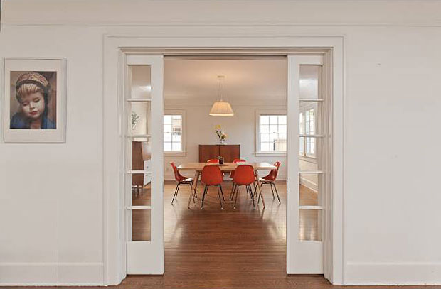 The pocket sliding French doors between the living room and the dining room are a great touch and contribute to the clean lines that mark the interior of this home.