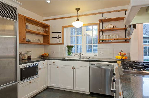 What makes this kitchen cool is the choice of open shelves, which evoke a country cottage feel. And yet they work perfectly with all of the modern design elements of the kitchen, including stainless appliances. Awesome.