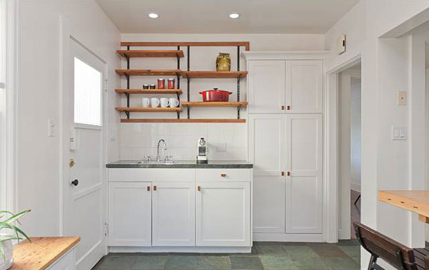The other thing I really like about this kitchen is that an eat-in bar occupies the portion of the room that leads out to the backyard. The cabinetry, windows and loads of natural light make this a perfect extension to the kitchen.