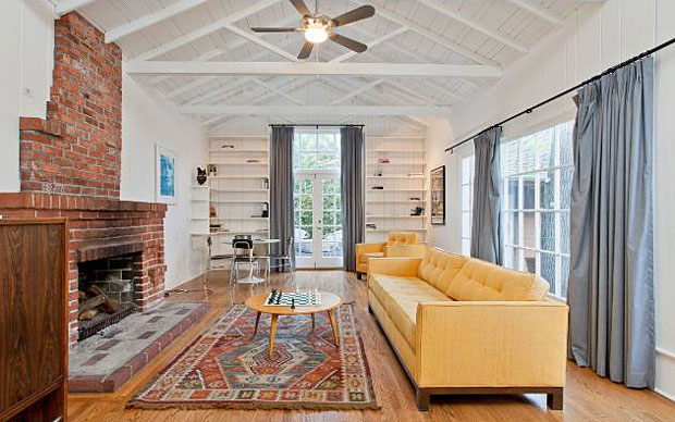 The open rafters, brick fireplace. built-in bookshelves and huge windows make this Great Room just that – great.
