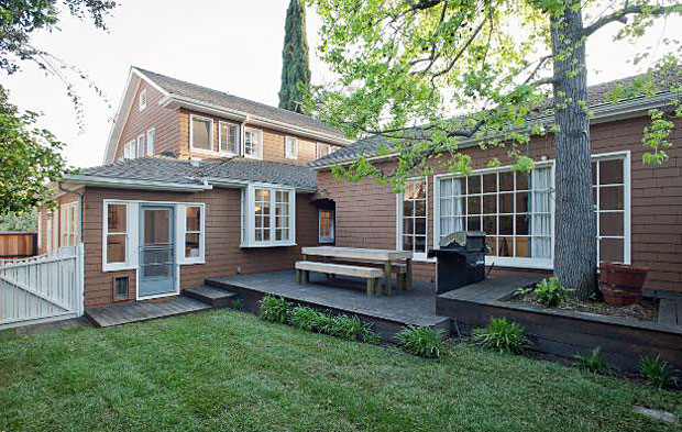 A wood patio deck and grassy, private yard is always a good thing.