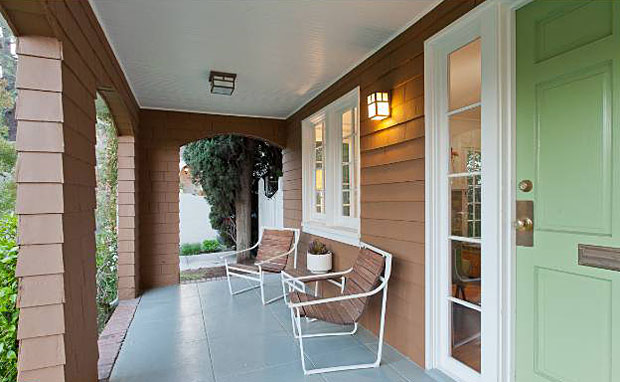 Who wouldn't enjoy a covered front porch where you can sit and watch the happenings of the neighborhood? And I would keep the green door!