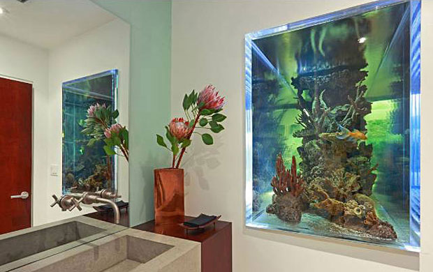 If you want to ensure your guests don't poke around in your bathroom, give them something to look at! Maybe that was the idea behind building one end of the aquarium into the wall of this bathroom. Love it. And, no, it's not possible to peek into the bathroom from the outside.
