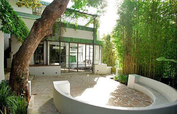 The yard features a tranquil terrace, a jasmine covered walkway, bamboo tree-lined sitting area and much more.