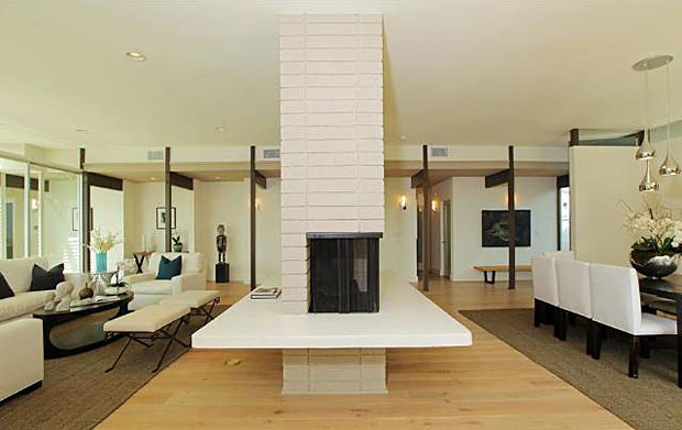 The large, light-filled dining room is separated from the living room by this badass, two-sided brick fireplace that serves the both rooms.