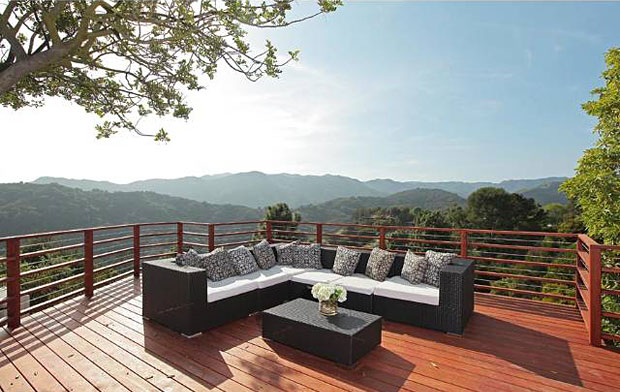 A canyon-facing redwood deck, perfect for dining al fresco and watching the endless sunsets.