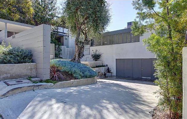 Borrowing from his mentor Richard Neutra, with whom Soriano interned, the home's entry is elegantly framed with signature bands of steel-framed windows.