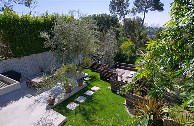 The home is beautifully sited on a 7,507 square foot lot that features lovely terraces and gardens.