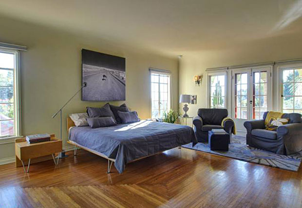 When there are so many stunning features to take in, it's easy to overlook some of them. The beautiful pattern of the hardwood floor in this bedroom is a good example.