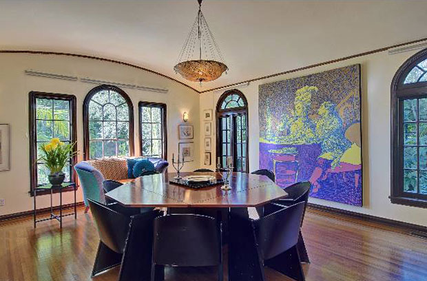 Like the living room, the home's large formal dining room has a gracious quality to it thanks to the stained glass windows, coved ceiling and the deep, arched doorways leading to it.