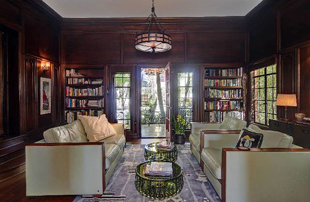 This library ain't no stuffy retreat. It's certainly warm, with its dark, mahogany covered walls. But with its large windows and doors to the outside, it's also an airy open space. You gotta love that combo.