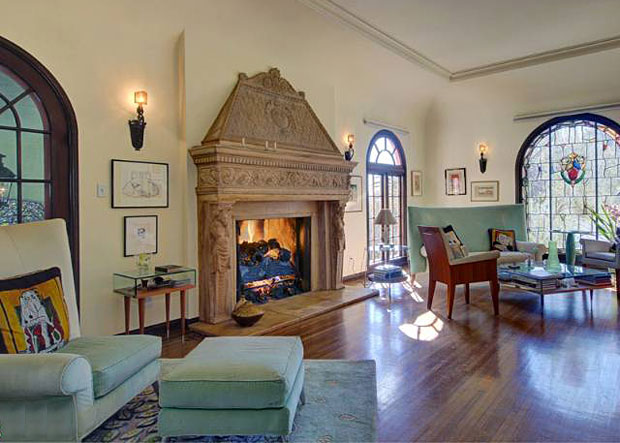With huge arched windows of stained glass and a massive Italianate fireplace, this step-down living room was clearly designed to impress. And it does.
