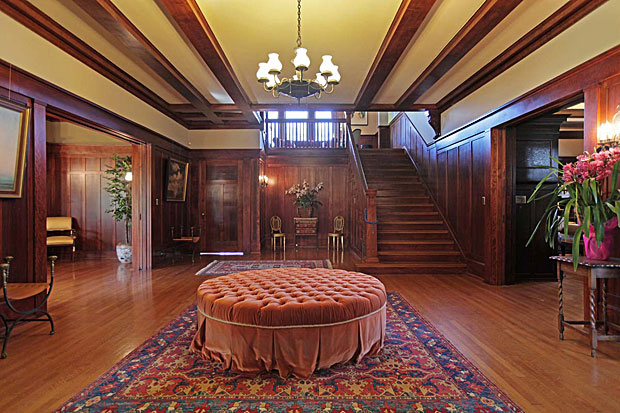 he main level is designed for living and entertaining in style, starting with this striking mahogany-paneled entry hall with rising staircase.